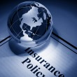 Stock Photo: Globe and Insurance Policy