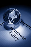 Globe and Insurance Policy — Stock Photo