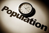 Clock and word of Population for background — Stock Photo