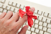 Red bow on finger — Stock Photo