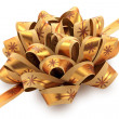 Golden gift bow with ribbon. — Stock Photo