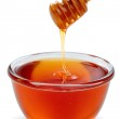 Wooden dipper with bowl of honey. — Stock Photo