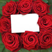 Rose bouquet with a note. — Stock Photo