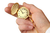 Golden pocket watch in a businessman's hand. — Stock Photo