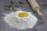 Egg and flour for baking cookies — Stock Photo