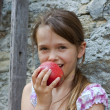 Girl is eating fruits — Stock Photo #5750285