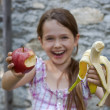 Girl is eating fruits — Stock Photo #5750307