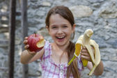 Girl is eating fruits — Stock Photo