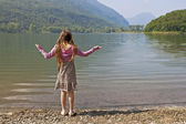 Girl at tarn — Stock Photo