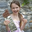 Stock Photo: Girl eats chocolate