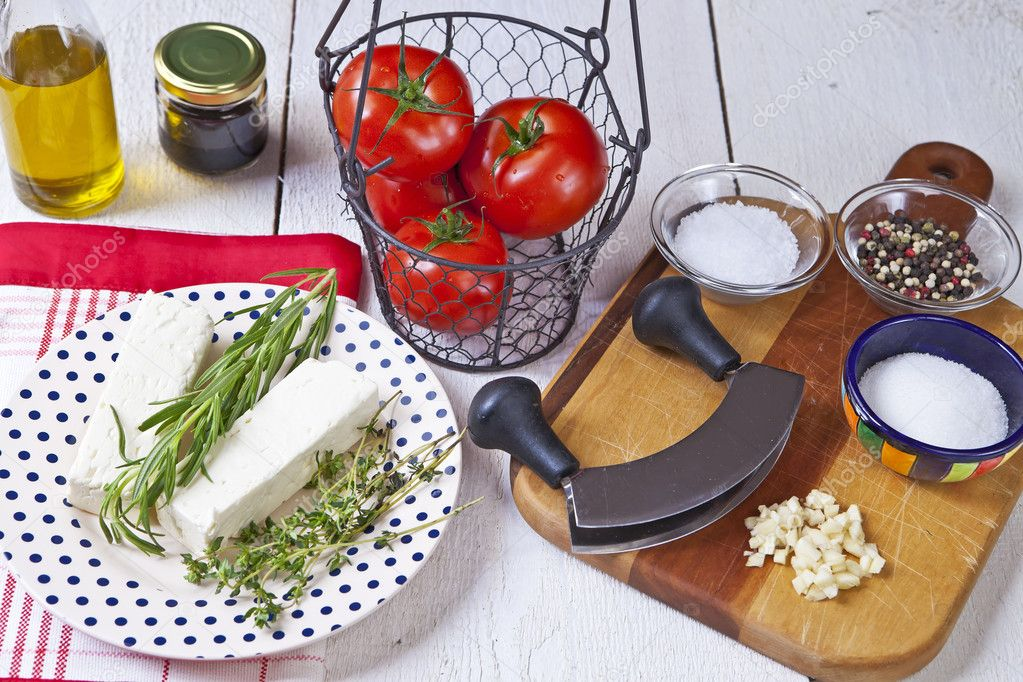 Fresh vegetables for a light summer meal with feta cheese and tomatoes — Stock Photo #5874105