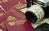 EU passports on a map with key and camera — Stock Photo
