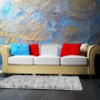 Royalty-Free Stock Photo: A modern interior with a sofa and a carpet