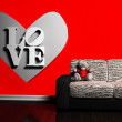 Stock Photo: Romantic interior with heart and sofa