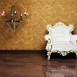 Stock Photo: Interior design with a classic elegant armchair and a chandelie