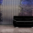 Interior in grunge style with a black sofa — Stock Photo