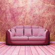 Interior design scene with a nice sofa on the grunge background — Foto Stock