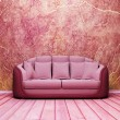Interior design scene with a nice sofa on the grunge background — Стоковая фотография