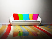 A modern interior with a sofa and the colored pillows — Stock Photo