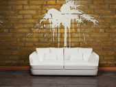 Modern interior design with a white sofa on the brick wall — Stock Photo