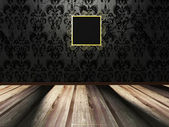 Golden frame on the vintage dark wall — Stock Photo