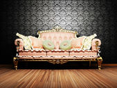 Modern interior design of living room with a royal sofa — Stock Photo