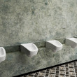 Stock Photo: Urinals in row, public toilet