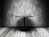 Black table in old grunge interior — Stock Photo