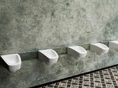 Urinals in a row, public toilet — Stock Photo