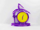 Creative violet and yelllow clock — Stock Photo
