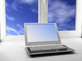 Laptop and a window, — Stock Photo