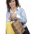 Stockfoto: Woman holding shopping bags