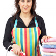 Stock Photo: Housewife close to towels stacked