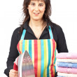 Housewife close to towels stacked — Stock Photo