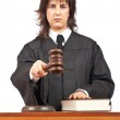 Angry female judge pointing at you in a courtroom. Focus on gavel and shallow depth of field — Stock Photo #5880461