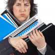 Busy business woman carrying stacked files — ストック写真