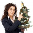 Holding a christmas tree — Stock Photo #5880680