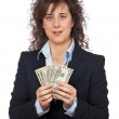 Holding a fan of money — Stock Photo