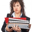 Busy business woman carrying stacked files — Stock Photo