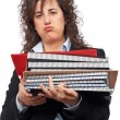 Busy business woman carrying stacked files — Stok fotoğraf