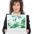 Business woman showing a laptop — Stockfoto