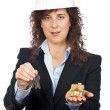 Female architect holding the keys and the house — Stock Photo