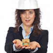 Female architect holding and showing the house — Stock Photo