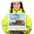 Showing a building construction on the laptop - Stock Photo