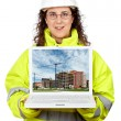Showing a building construction on the laptop — Stock Photo