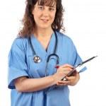 γυναίκα γιατρό εγγράφως — Φωτογραφία Αρχείου