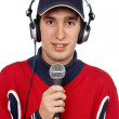 Disc jockey with headphones and microphone — Stock Photo #5880996