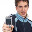 Teenager showing cell phone screen — Stock Photo #5881007