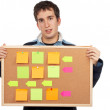 Holding the corkboard with notes — Stock Photo #5881030