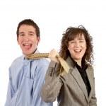 Businesswoman who pulls the necktie — Stock Photo